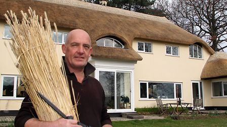 Sidmouth thatcher, Mark Smith, finishes his latest roof at Pooh Cottage on Bear Lane, Knowle. Ref sh