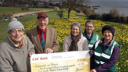 Neville Staddon and Handel Bennett hand over a cheque to Lynette Talbot,Peter Endersby and Cheryl Al