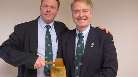 Simon Lane (left) hands over the presidential bell and gavel to new Devon Rugby Referees Society (DR