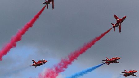 The spectacular Red Arrows pictured performing at Lyme Regis. Ref shs 8596-31-12AW. Picture: Alex Wa