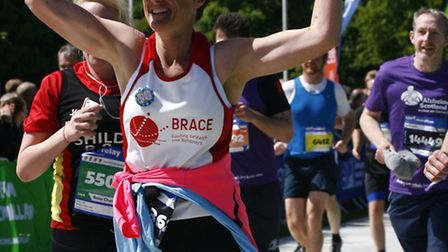 Jo Earlam crossing the finish line