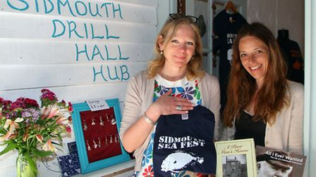 Louise Cole and Kate Barber in the new Sidmouth Drill Hall Hub shop in Libra Court. Ref shs 8624-24-