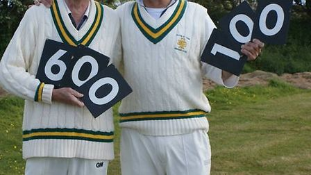 David O'Higgins and Justin Quick celebrate their individual milestones for Tipton St John Cricket Cl
