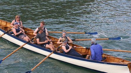 The Lyme Regis mixed gig crew in action at the Bridport Regatta
