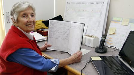Sheelagh Pearson looking at the entries of her diary on her last before she retires. Ref shs 7864-23