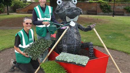Lynette Talbot and Bobby Stacey of Sidmouth In Bloom start to plant our the Toad of Toad Hall floral