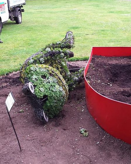 Sidmouth In Bloom's Toad of Toad Hall was pulled out of its boat and damaged by vandals.