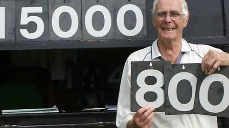 Tipton St John bowler David O'Higgins holds up the numbers to show how many wiickets he has taken in