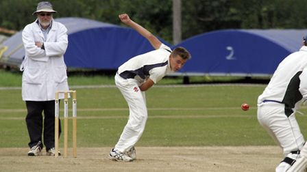 Ollie Reed bowling at home for Ottery. Ref shsp 9138-26-15TI. Picture: Terry Ife