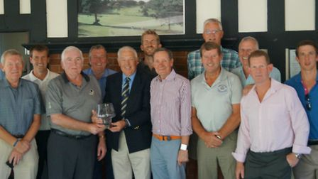 Sidmouth B team with the Andy Harrison Trophy after their two-leg success over Honiton.