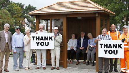 Thank-you £6,840 times over! Cllr John Dyson with some grateful bus passengers. Picture: terry ife