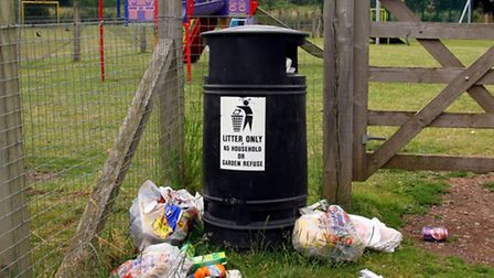 an overflowing rubbish bin at Newton Poppleford playing fields. Ref shs 3132-29-15AW. Picture: Alex
