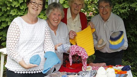 Rosalin and Duncan Watt,Jean Bridgeman and Joan Bennett with some of their knitted items for Uganda.
