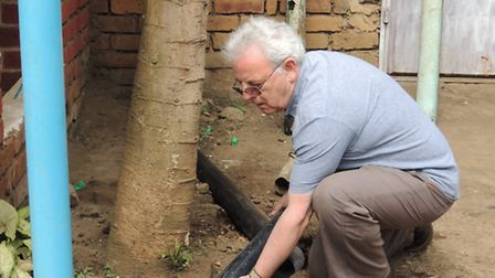Graham Green replacing some piping at school in Arusha
