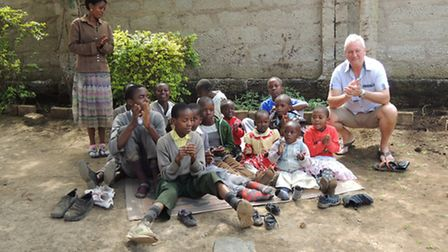 Graham Watson with some of the children from the school