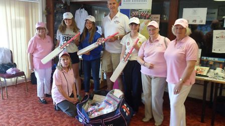 Former Somerset and England cricketer Andy Caddick presents a bag of equipment to the East Devon Dis