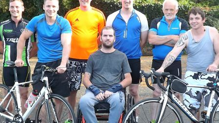 Jake Pengelly with the six cyclists fundraising for power-assisted wheels for his wheelchair