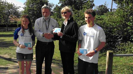 Reverend Mac Dick present prizes to the runners-up in Ottery Station logo competition