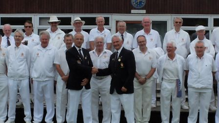 Sidmouth Bowls Club Captains Day and the men's captain and vice-captain shake hands in front of the