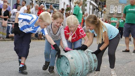 Beer barrel rolling as part of the regatta week. Ref shb 2275-33-15TI. Picture: Terry Ife