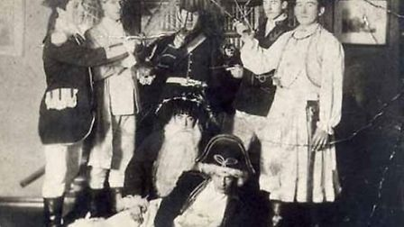 A troupe of mummers in Sidmouth led by Arthur Baker of Sidbury. The picture is beleived to have been