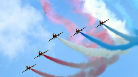 The spectacular Red Arrows pictured performing at Lyme Regis. Ref shs 8629-31-12AW. Picture: Alex Wa
