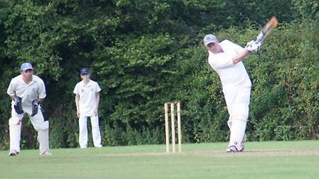 Tipton St John batsman Phil Tolley slams the ball to the boundary on his way to his 116 not out agai