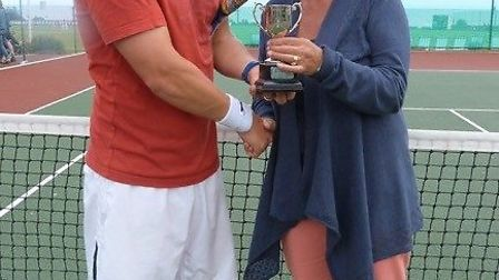 Mike King receives his trophy from Debbie Snelgrove