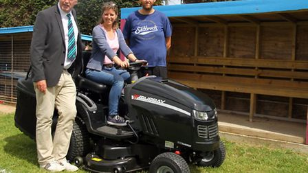 Jeremy Schofield, Sidbury United Football Club manager, receives a new lawn mower for the club from