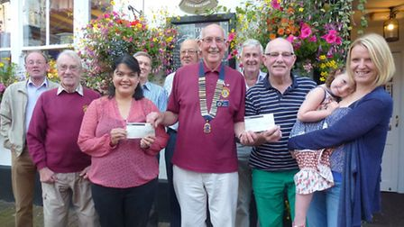 Lion President Ian Skinner presenting cheques to the local winners of the 2nd and 3rd prizes in last