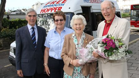 The Revd Handel Bennett is pictured presenting a bouquet of flowers to Mary Buckley with cllr John D