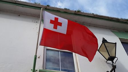 Red and white Tongan flags are flying in Sidmouth