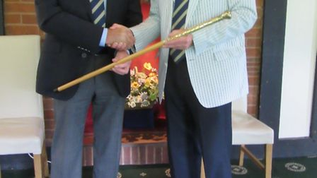 The Walking Stick being presented to the winner Ray Gunston from the Seniors Captain David Bromage