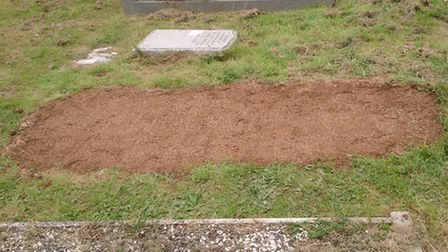 Grave in Sidury Cemetery after EDDC staff refilled and reseeded it