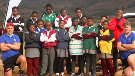 Tom and Will Counsell with young rugby players in Swaziland where they volunteered for four weeks