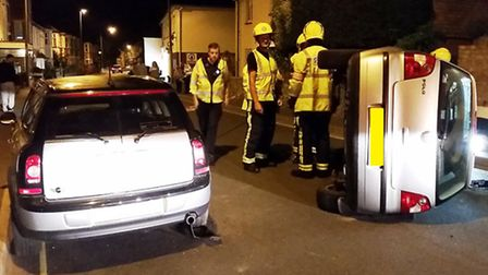 A VW Polo overturned in a collision with a parked car in Temple Street