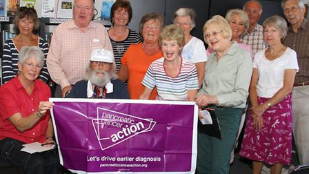 Kingsley Squire with volunteer fundraisers for Pancreatic Cancer Action. Ref shs 8456-37-15AW. Pictu
