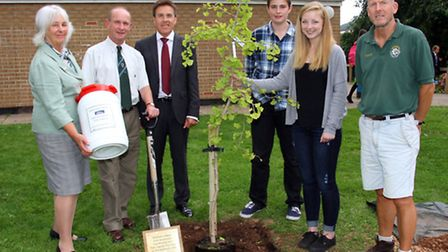 Sidmouth College headteacher, Kenny Duncan, with former head boy and girl Derek Cody and Linda Sherr