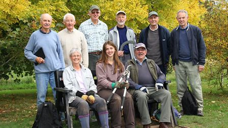 The SVA working party take a break from their duties in Margaret's Meadow on Monday which included c