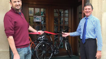 Sid Valley Cycle Club chairman Ron Clint cuts the ribbon on Cycle Service