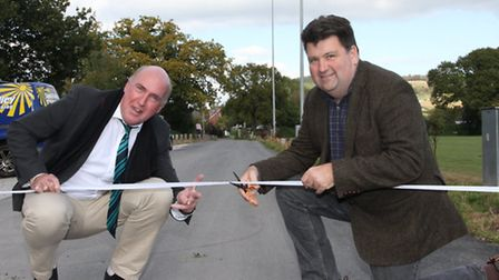 Councillors Stuart Hughes and Iain Chubb cut the ribbon on the recently surfaced access road to the