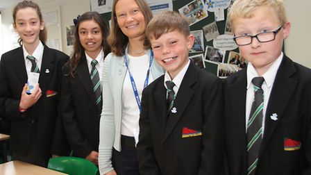Rachel Johnstone from the Sid Valley Memory Cafe is pictured with some of the year seven students fr