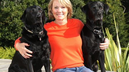 Clare Harvey pictured with her dogs Todd and Mack was delighted that a letter she dropped in the Bye