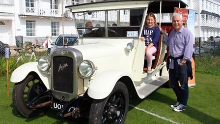 A summer car rally was held at Sidmouth Cricket Club at the weekend. Grace Jeffrey, nine, with her d