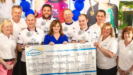 The Sid Valley Cyclo-paths handing over their cheque to Dream-A-Way