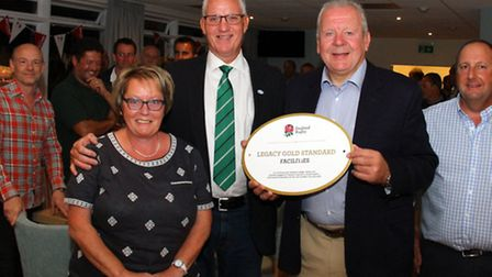 Bill Beaumont presents a Legacy Gold Standard award to Lester Wilmington, chairman of Sidmouth Rugby