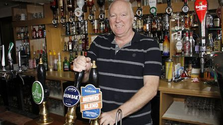 Ron Miles behind the bar at the lamb & flag in Ottery. Ref sho 3816-39-15TI. Picture: Terry Ife