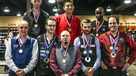 Ottery's Adam 'Carnage' Nickels with medal winners at World Artistic Pool Championships