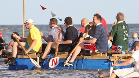Competitors in the Sidmouth Regatta raft race in 2013. Photo by Simon Horn. Ref shs 7581-35-13SH To