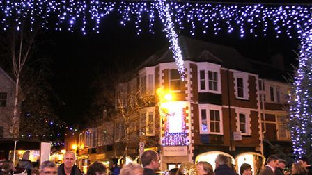 Crowds gather for the Christmas lights switch on in Sidmouth's town centre on Saturday. Photo by Sim